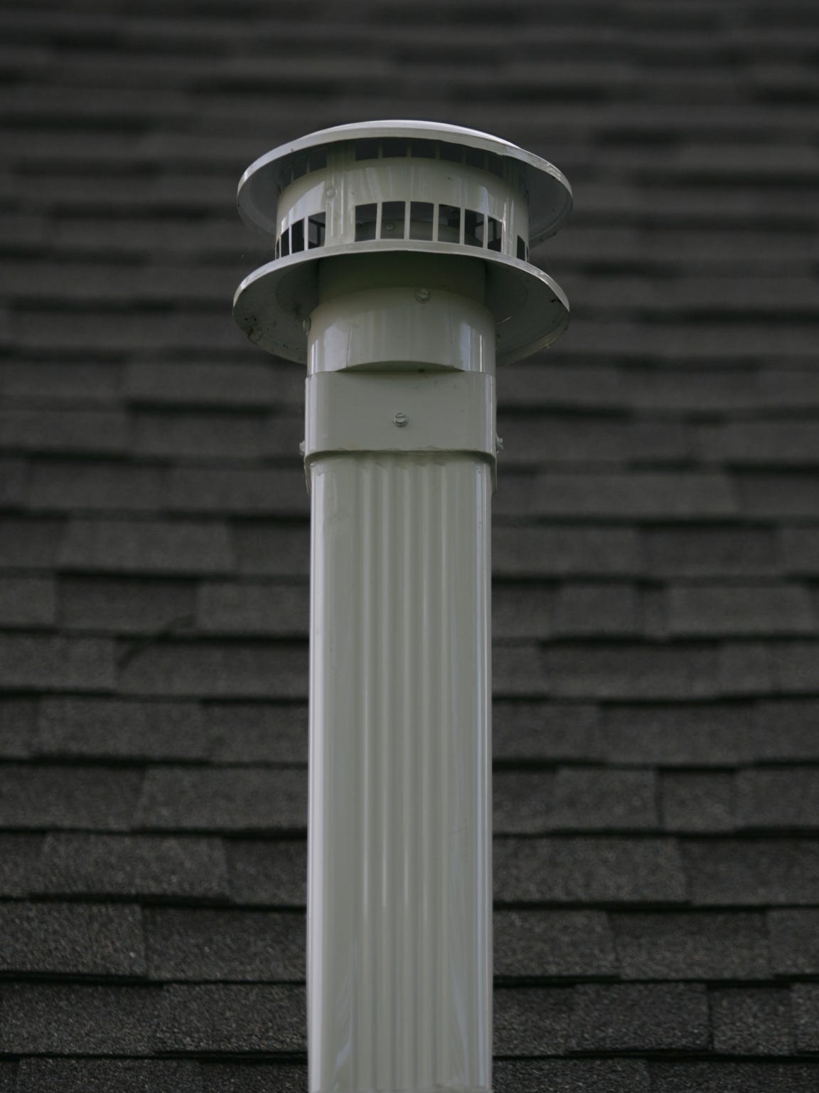 A pipe on the exterior of a Pompton Lakes house that is part of a vapor mitigation system which pulls potential cancer-causing solvent vapors from beneath the basement and releases them into the outside air.