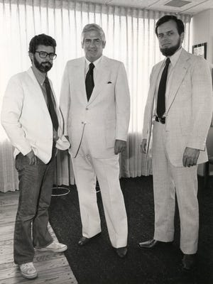 """""""Star Wars"""" creator George Lucas, left, Kenner Products CEO Bernard Loomis, center, and """"Star Wars"""" producer Gary Kurtz announce the deal for Kenner's """"Star Wars"""" toys in this rare 1977 publicity photo."""