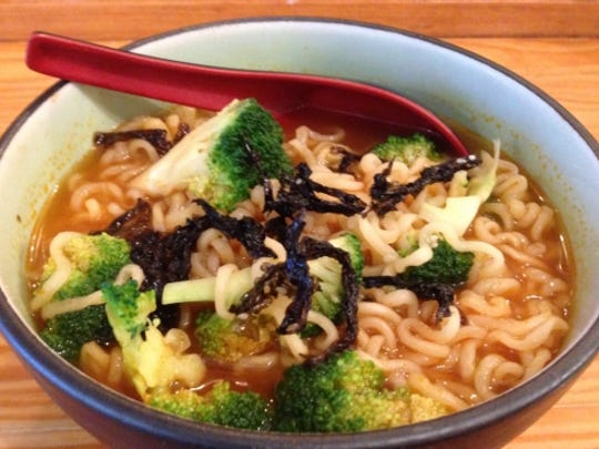 Fugu Tei's spicy noodle was curly strands of tender noodles swimming in a pool of spicy broth.