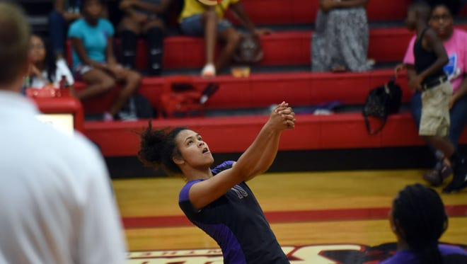 Hattiesburg High sophomore Taytum Terrell hits back the ball during a game against Petal High School on Friday.
