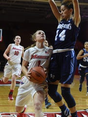 Marist College's Claire Oberdorf drives into a Saint
