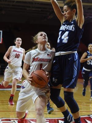 Marist College's Claire Oberdorf drives into a Saint Peter's defender on Jan. 25 at McCann Arena.