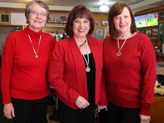 From left, Diane Watson, Tammy Roberson and Janet Owen are members of the Oregon Spirit Chorus and are selling singing Valegrams for Valentine's Day.
