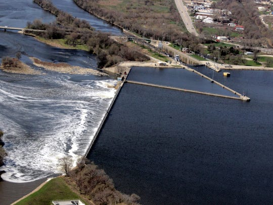 Aerial view of Brandon Road Lock and Dam, Joliet, Ill., April 22, 2014. Brandon Road Lock and Dam has been identified by the Corps Great Lakes and Mississippi River Interbasin Study (GLMRIS) Team as the downstream control point of the Chicago Area Waterway System for a number of different aquatic nuisance species controls; the topographic and geographic positioning of the site in the hydrology of the CAWS allows it to serve as a single point of passage for any species able to move upstream toward the Great Lakes. The lock has been operational since 1933.