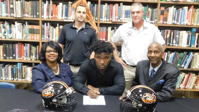 Marlon Young announced on Wednesday that he has signed to play football with Georgia State. The Opelousas High senior announced his decision in front of his teammates coaching staff and  family members during a brief ceremony in the school library. With Young on signing day were his mother, Marilyn J. Young, and father, Marvin C. Young. Behind the family are OHS defensive coordinator Kip Duplechine and head football coach Doug Guillory.