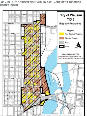 Early neighborhood beautification efforts for the near west side will take place in a Tax Increment District. Many properties in the district were classified as blighted in 2012.