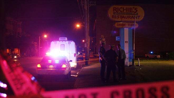 A man in his 20s was shot in the head Tuesday night in the Richie's Restaurant parking lot.