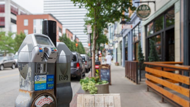 Rates for parking meters on Vine Street in Over-the-Rhine are going up next month and will run until 11 p.m. three days a week. Picture taken on Vine Street, Monday, July 2, 2018.