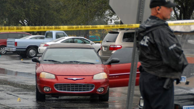 The shooter retrieved a gun from this red Chrysler Sebring convertible to stop his attackers, police say. Its engine remained running hours after the Jan. 30, 2014, incident at the Palm Bay campus of Eastern Florida State College.