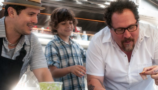 "John Leguizamo, left, Emjay Anthony, and Jon Favreau in ""Chef."""