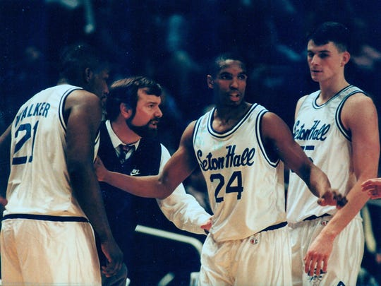 Seton Hall's Terry Dehere (24) meets with his team