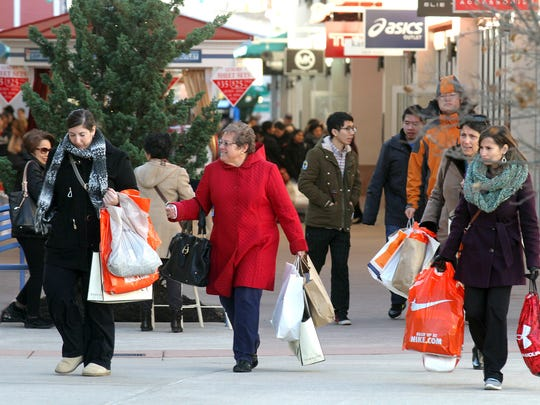 Shoppers are shown at the Jersey Shore Premium Outlet