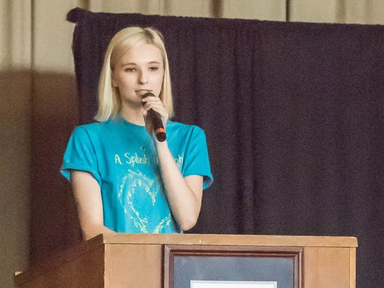 Calhoun Christian School senior Hannah Huling speaks about her experiences on a school community service trip to the Dominican Republic during a school assembly.