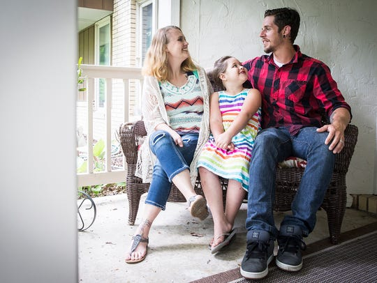 Danielle and Ryan Lam with their daughter at their