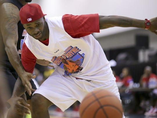 Former Indianapolis Colts receiver Reggie Wayne participates in a celebrity basketball game at Summer Celebration in 2013.