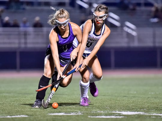 Chambersburg's Morgan Mentzer (10) pressures Mifflin County's Gabrielle Mink (4) during a field hockey game on Saturday, Oct. 15, 2016 at Trojan Stadium. Chambersburg defeated Mifflin County 3-2.