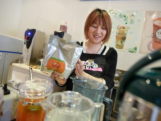 Owner Jinlan Lu mixes a drink at ViVi Bubble Tea Wednesday, March 21, in St. Cloud.