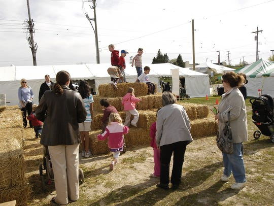 Kids can climb on bales of straw this weekend at the