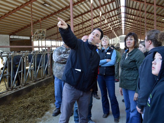 Governor Scott Walker visits Birlings Bovines in Black Creek on April 25 to assess the damage from recent April snowstorms and to hear about how it impacted operations.