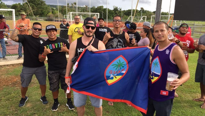 Fans hold up the Guam flag at the Matao vs. Oman 2018 World Cup Qualifying game Tuesday, Sept. 8.