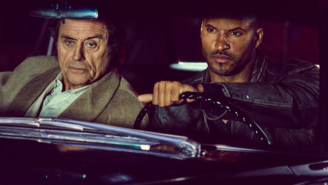Ian McShane (Mr. Wednesday) and Ricky Whittle (Shadow-Moon)