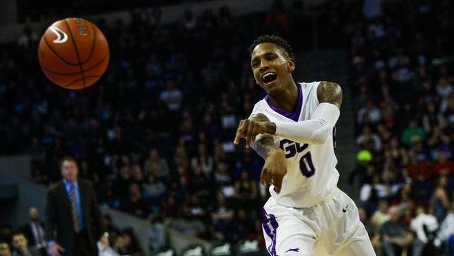 Grand Canyon University guard DeWayne Russell passes the ball as Grand Canyon University faces off against Seattle University on Saturday, Jan. 30, 2016, at Grand Canyon University Arena in Phoenix, Ariz. Seattle University defeated Grand Canyon University 59-57.