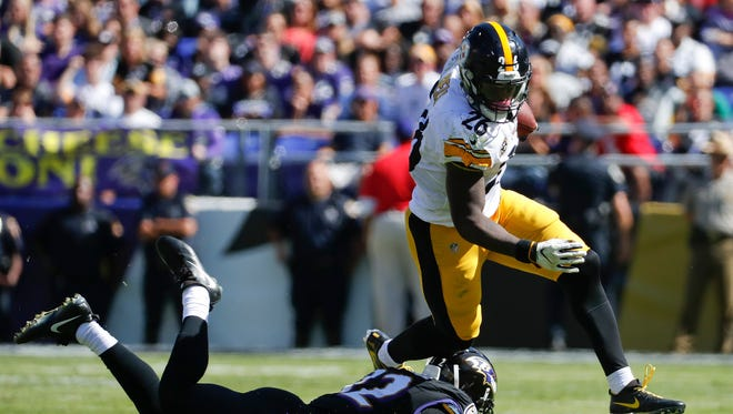 Pittsburgh Steelers running back Le'Veon Bell (26) runs past Baltimore Ravens free safety Eric Weddle (32) during the first half in Baltimore, Sunday, Oct. 1, 2017. Bell finished with 144 yards rushing.