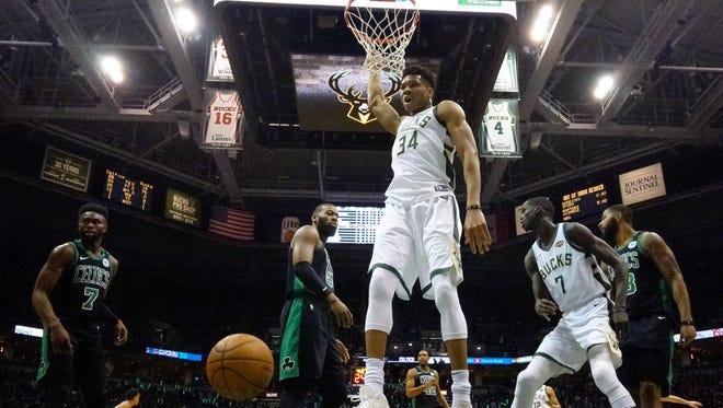 Giannis Antetokounmpo finishes off a dunk. His tip-in with 5.1 seconds left helped tie the Eastern Conference playoff series against Boston.
