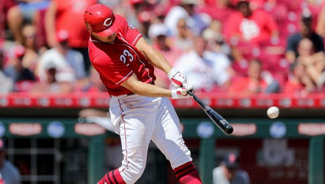 Cincinnati Reds left fielder Adam Duvall (23) doubles in the eighth inning during a National League baseball between the St. Louis Cardinals and the Cincinnati Reds, Wednesday, July 25, 2018, at Great American Ball Park in Cincinnati.