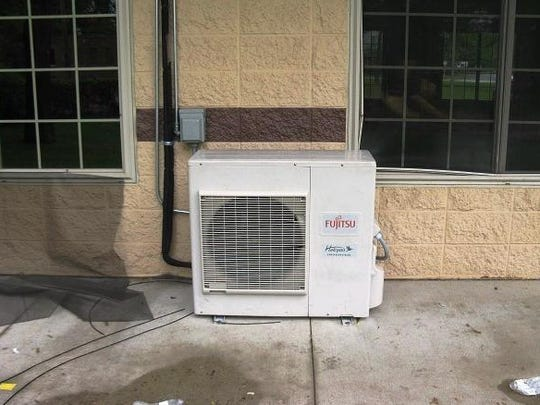 Damaged Screens and Air Conditioner