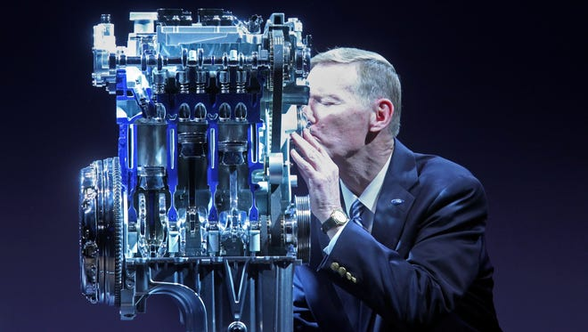 Ford CEO Alan Mulally gives a kiss to the 1-liter engine, which is now going into the Fiesta subcompact in the U.S.