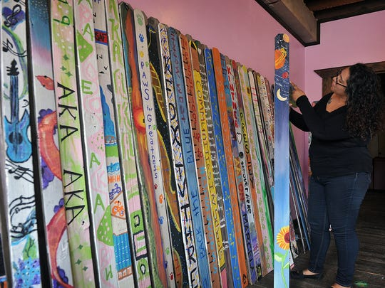 Vanessa Alonzo, program director for the Wichita Falls Alliance for Arts and Culture, talks about a small sampling of the hundreds of fence pickets painted by artists for the Don't Fence Me In public art project. Deadline to participate is July 3rd.