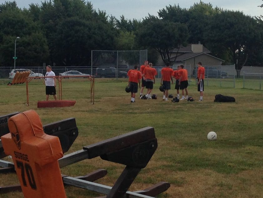 Washington football players prepare for practice Thursday.
