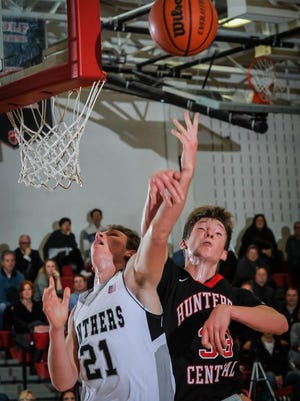 Bridgewater-Raritan's Cole Harper (left) and Hunterdon Central's Christian Shaw go up for the ball during their game on Tues. Dec. 22, 2015 in Bridgewater. Photo by Jeff Granit