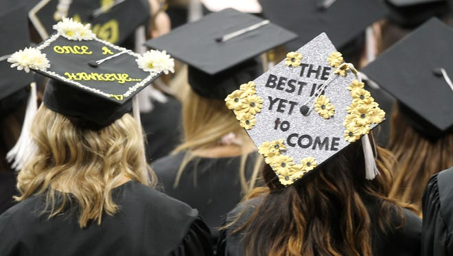 The newest graduates of the University of Iowa, many with caps decorated, attend commencement ceremonies for the College of Liberal Arts and Sciences and University College on Saturday, May 13, 2017, at Carver-Hawkeye Arena.