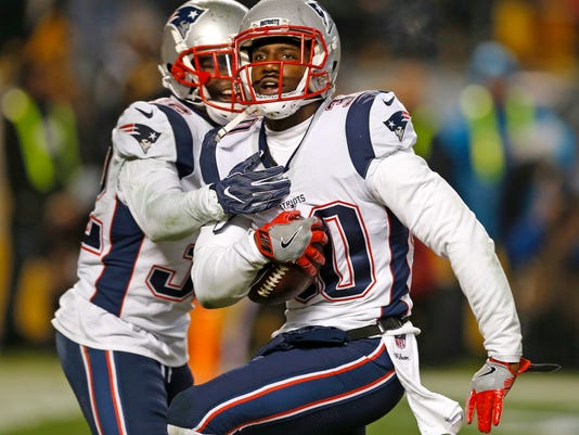 FILE - In this Dec. 17, 2017, file photo, New England Patriots strong safety Duron Harmon, right, celebrates his interception in the end zone of a pass from Pittsburgh Steelers quarterback Ben Roethlisberger during the second half of an NFL football game in Pittsburgh. Since signing a four-year, $17 million contract this past offseason, Harmon has become a more vocal presence in the Patriots' locker room and was one of its most consistent players down the stretch. (AP Photo/Keith Srakocic, File)