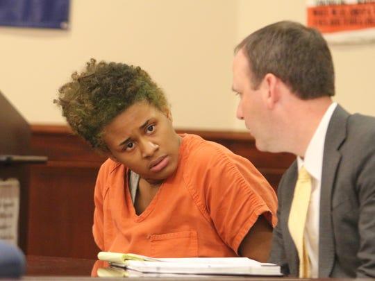 Kymber Green talks to her attorney, John Parker, at