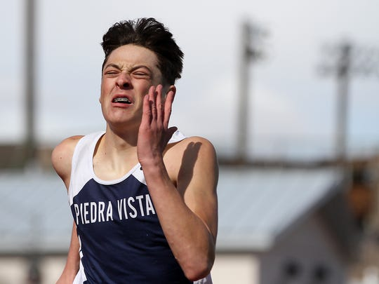 Piedra Vista's Michael Gonzales competes in the 4x200 relay on Saturday at Hutchison Stadium.