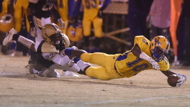 Bay Springs wide receiver Marcel Cole Jr. reaches for extra yards against Bassfield last Friday.