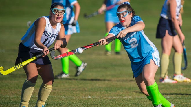 Essex's Maddie Reed, left, and South Burlington's Kate Hall follow the ball in Essex Junction on Friday, October 7, 2016.