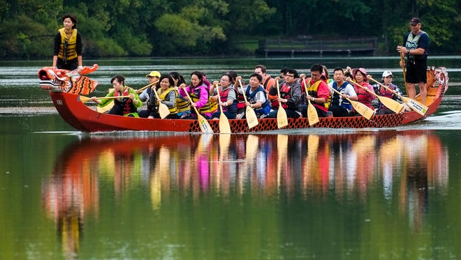 A dragon boat crew gets some practice and instruction for Sunday's race at Hawk Island County Park  on Saturday, Sept.17, 2016.