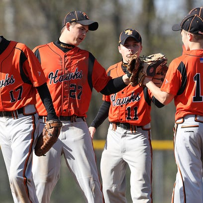 Port Edwards baseball players watch from the dugout during a non-conference baseball game against Menominee Indian High School in Port Edwards , Friday, April 29, 2016.