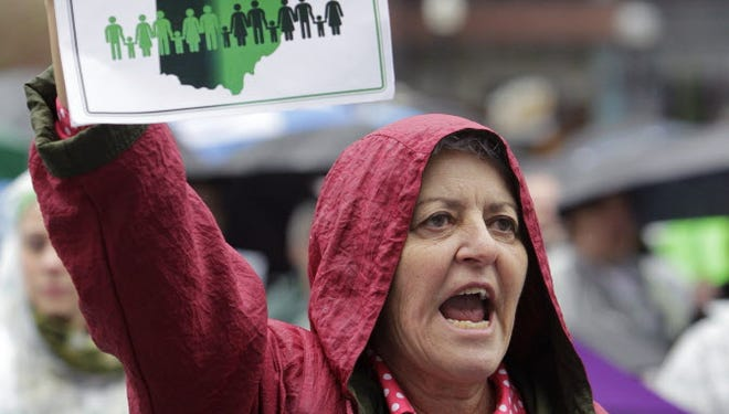 Paddy Kutz shows her support for Medicaid expansion at a rally last year in Columbus, Ohio.