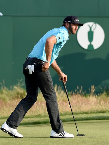 Dustin Johnson watches his putt on the 18th during his second round at The 143rd Open Championship at the Royal Liverpool Golf Club.