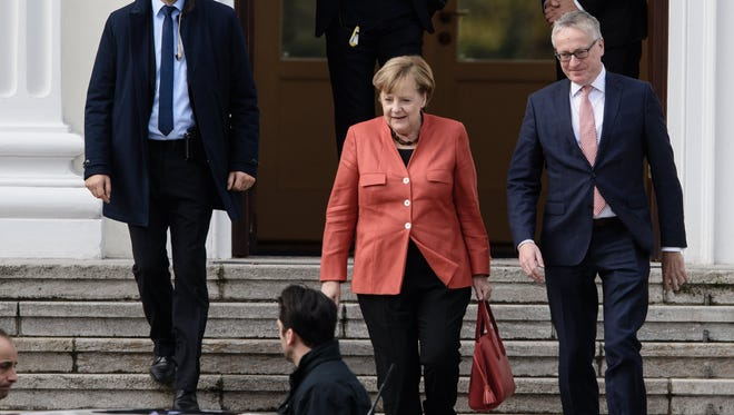 German Chancellor Angela Merkel of the Christian Democratic Union (CDU) leaves after a meeting with German President Frank-Walter Steinmeier (not in the picture) at the seat of the German President, the Bellevue Palace, in Berlin, Germany, on Nov. 20, 2017.