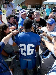 Indianapolis Colts running back Vick Ballard talks to the hoard of media members following their morning walkthrough practice on the first day of training camp Sunday at Anderson University in Anderson, Ind.