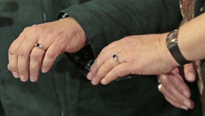 Judi Trampf and Katy Heyning of Madison show their rings in Madison last October. They were married in January.