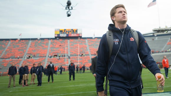 Auburn Tigers quarterback Sean White (13) looks on during Tiger Walk before the NCAA football game between Auburn and Ole Miss on Saturday, Oct. 31, 2015, at Jordan-Hare Stadium in Auburn, Ala.