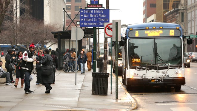 The IndyGo bus stop at Ohio and Pennsylvania streets in Downtown Indianapolis was packed with riders on Jan. 29, 2015.