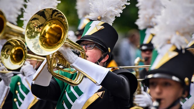 Sauk Rapids-Rice High School Marching Storm band members perform during the Rapids River Days Parade Friday, June 23, 2017 in Sauk Rapids. More than 70 units were scheduled to take part in the parade.